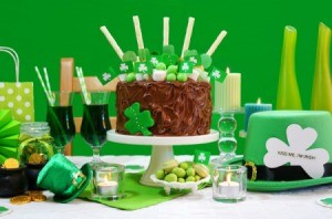 Shamrock cake surrounded by St. Patrick's Day decorations