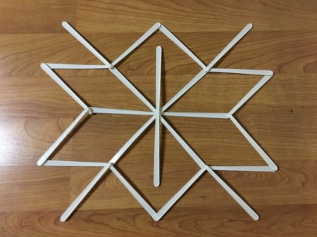 Stick and Yarn Snowflake Decoration - glue more sticks