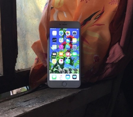 A smartphone against a window.