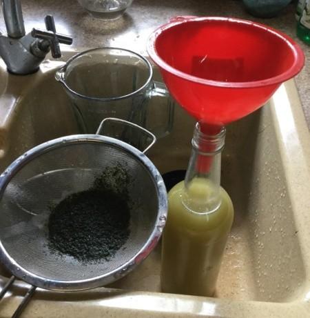 straining Mint Oil into bottle