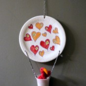 Hot Air Balloon Decoration - finished paper plate and plastic cup hot air balloon hanging on the wall