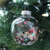 Clear Ornaments with Christmas Confetti  - ornament hanging on the tree