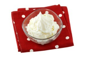 Bowl of vegetable shortening on a red polka dot napkin.