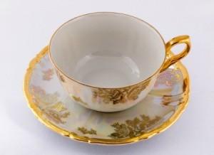 Gold rimmed porcelain teacup.