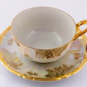 Gold rimmed porcelain teacup.