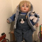 Identifying a Porcelain Doll - doll wearing a hoodie and overalls