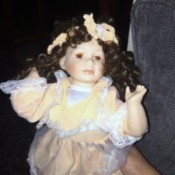 Value of Porcelain Dolls - doll with dark ringlets