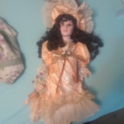 Identifying a Porcelain Doll - dark haired doll with apricot long dress