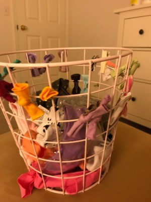 Using a wire waste basket to clip hair bows and accessories for organizing.