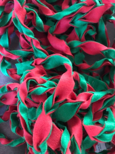Easy Christmas Felt Garland or Bracelet - pile of garland before wrapping on stair railing