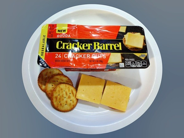 A package of Cracker Barrel gouda cheese.