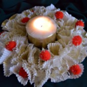Christmas Eve Pillar Candle Decoration - table wreath with lit candle