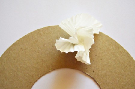 Christmas Eve Pillar Candle Decoration - make cupcake paper flowers and begin gluing to the wreath