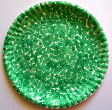 Let It Snow Paper Plate Craft - dap on undiluted green paint and allow to dry