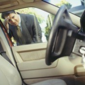 Man Looking at His Keys Locked In the Car