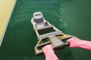 Carpet Shampooer Being Used on Green Carpet