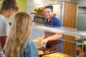 College Students Being Served in Cafeteria