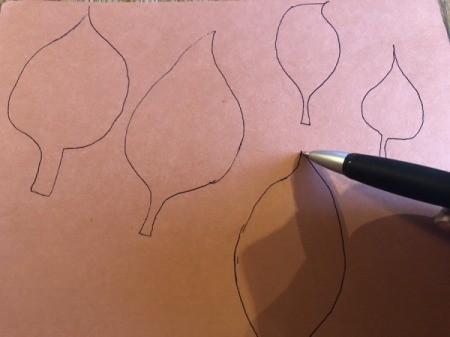 Making a Duct Tape Poinsettia - free hand draw five leaves on the cardstock