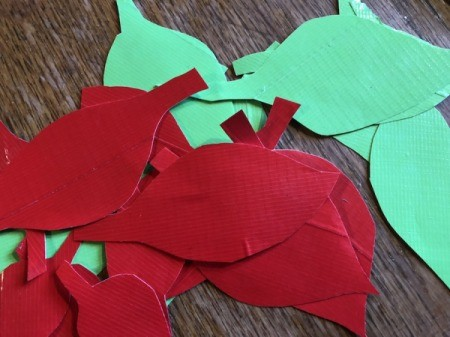 Making a Duct Tape Poinsettia - flip the pages over and cut out all of the leaves