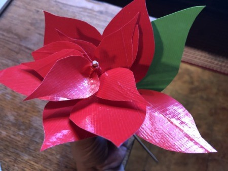 Making a Duct Tape Poinsettia - start taping the green leaves underneath