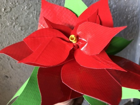 Making a Duct Tape Poinsettia - slip spiral on the top of the stick in the space left
