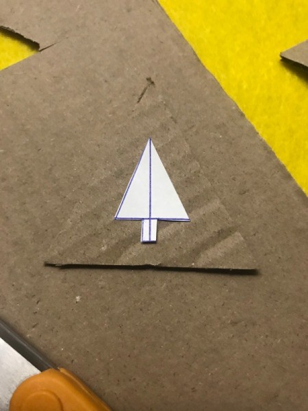 Christmas Triangle Candy Box Ornament  - draw a Christmas tree and use an Exacto knife to cut it out of the triangle