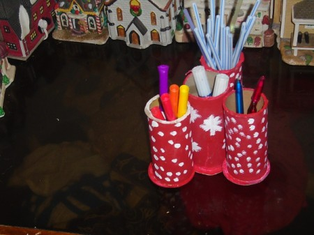 Using old decorated ribbon rolls as a pen holder