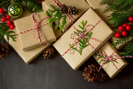 Christmas packages under a tree.