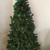 Setting Light Colors on a Pre-lit Christmas Tree - top lights colored an bottom are white