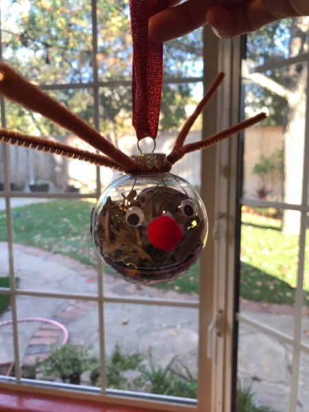 Cute Reindeer Ornament - hanging in front of a bay window