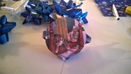 Christmas Card and Bow Window Decoration - circle cut from card with bow glued onto the back