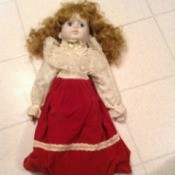 Identifying a Porcelain Doll - doll with fancy blouse, long red skirt, and red shoes