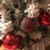 Poured Paint Ornaments - multicolored ball hanging on flocked tree