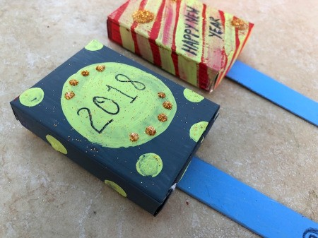 Snack Box New Year's Noisemakers - allow the glue to dry for at least 10 minutes