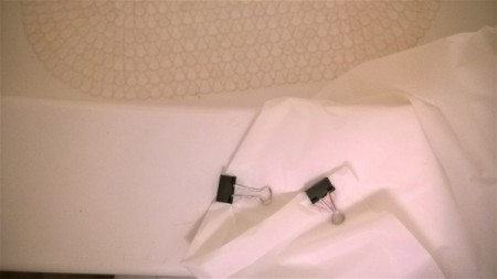 Binder clips to keep a shower curtain liner from billowing.