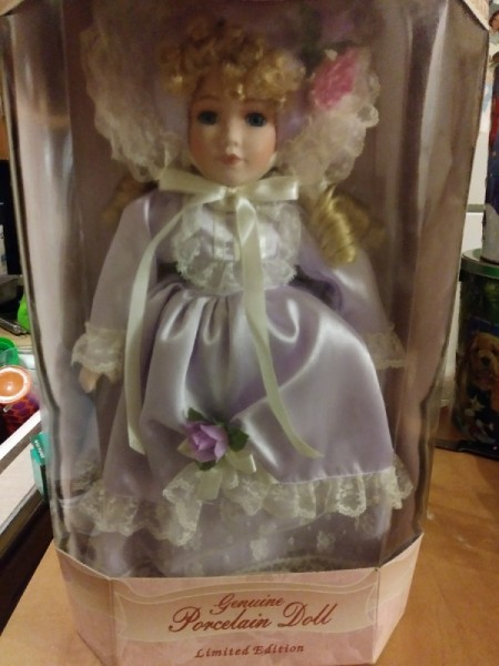 Value of Collectible Memories - Reesa Porcelain Doll - doll wearing a fancy white satin dress