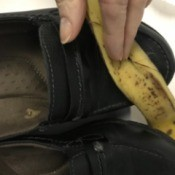Using a banana peel to shine your leather shoes.