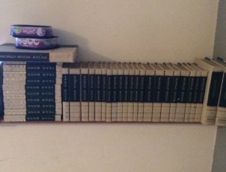 Value of the Encyclopedia Britannica - white leather bound volumes on a shelf