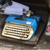 Repairing a Broken Smith Corona Typewriter Carriage - blue typewriter