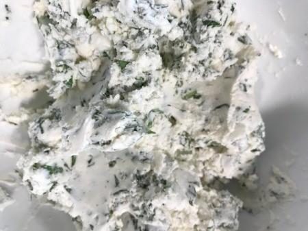 basil and cheeses mixed