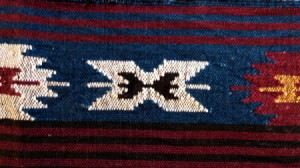 A South American woven rug with bright colors.