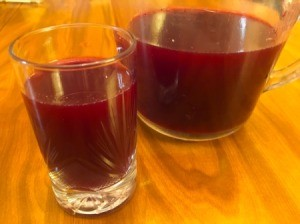 Juicing and Growing Your Own Pomegranates - container and glass of fresh juice