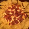 Baked Three Cheese Bacon Dip surrounded by chips