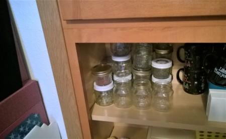Empty jars on a shelf.