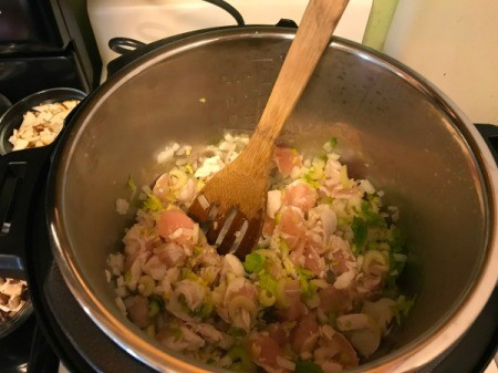 A pot of soup ingredients before being pressure cooked.