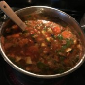 A pot of taco soup cooking on the stove.