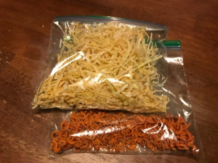 Onions and carrots dried in a food dehydrator.