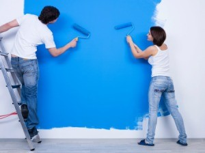 Couple Painting a Blue Wall