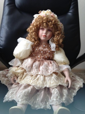 Finding the Value of a Porcelain Doll - doll in lacy dress