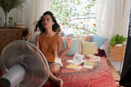 Woman Trying to Cool Off on Hot Summer Day